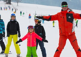 A child has lots of fun with their private skiing instructor from Skischule Zahmer Kaiser during a private ski lesson for kids of all levels.
