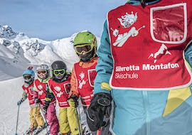 A group of children is having fun on the slopes of Silvretta Montafon during their Kids Ski Lessons (from 6 y.) for First Timers with Skischule Schruns.