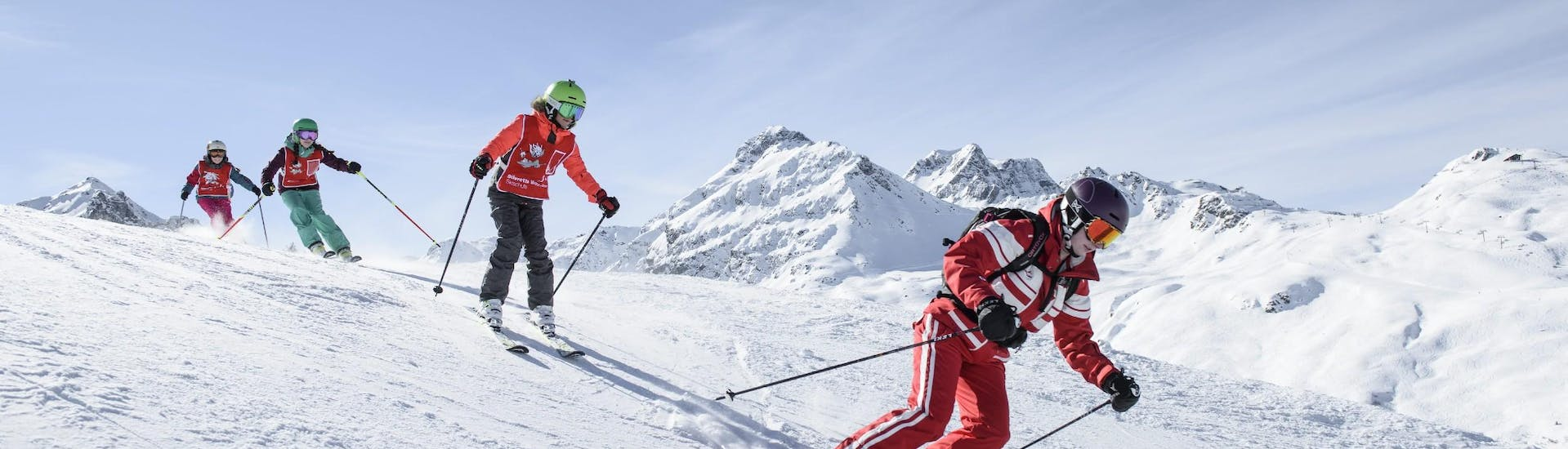During their Kids Ski Lessons (from 5 y.) for Skiers with Experience a group of children is exploring the slopes of Silvretta Montafon alongside their experienced ski instructor from Skischule Schruns.