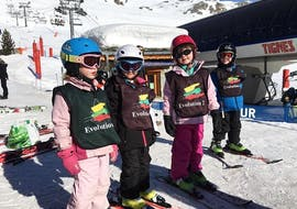 """Four young skiers are learning how to ski in the safe environment of the Kids Club of the ski school Evolution 2 Tignes during their Kids Ski Lessons """"Kids Club"""" (3-5 years) - Morning."""