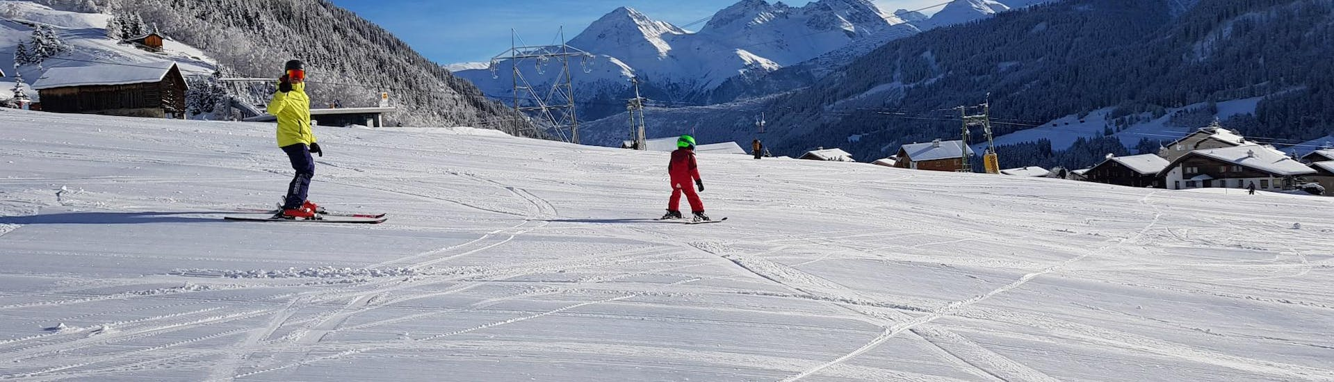 A private ski instructor is supervising a young skier during the Private Ski Lessons for Kids (from 3 years) - All Levels with Skischule Monntains.