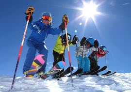 Young skiers and their ski instructor from the ski school Prosneige Les Menuires are getting ready to hit the slopes during their Kids Ski Lessons + Ski Pass (5-13 years) - Beginner.