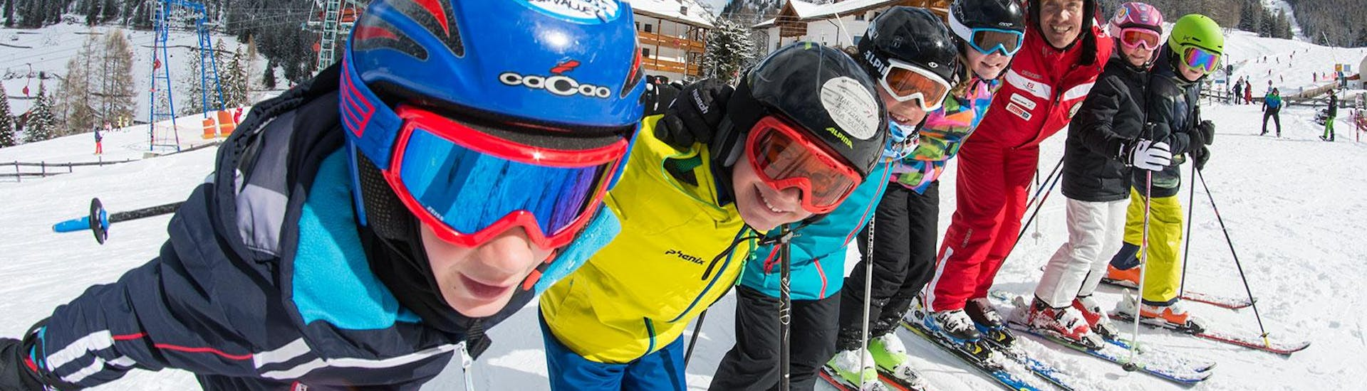 Kids Ski Lessons for Beginners (4-12 y.) - Full-Day with Ski and Snowboard School Selva Val Gardena - Hero image