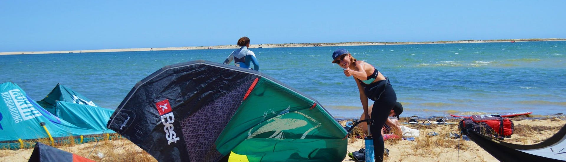 A participants of the kitesurfing lessons with Kite Culture Algarve is getting ready for her session on the Fuseta Lagoon.