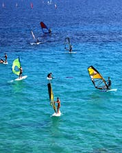 A group of windsurfers enjoying the beautiful weather on the ocean where you can do windsurfing and kitesurfing on the Brac Island.
