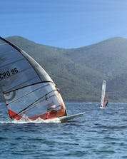 Several surfers are competing against each others in a race where you can do windsurfing and kitesurfing in Pelješac.