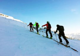 A group of skiers climb the snow-covered mountain with their Private Ski Touring Guide - All Levels from the Diablerets Pure Trace ski school.