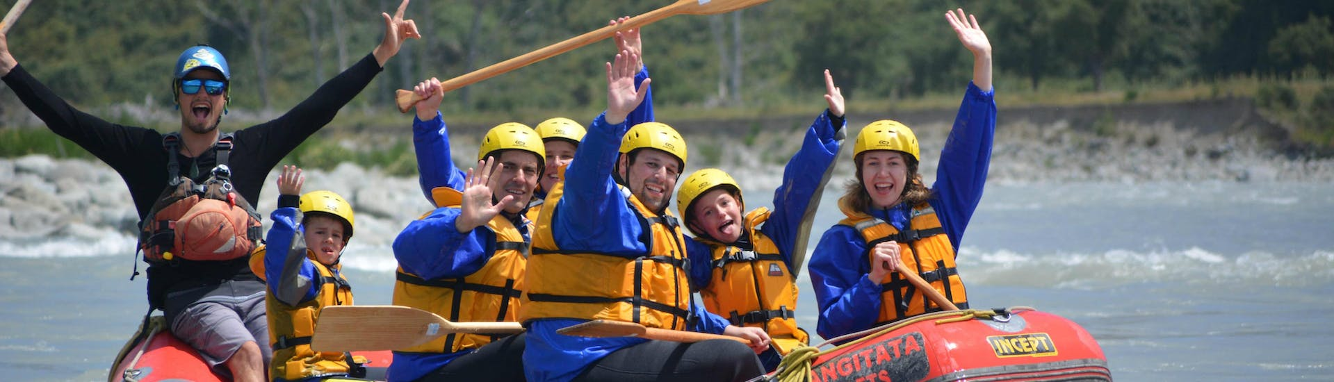 A family is having fun on the river during their Lower Rangitata Rafting with Christchurch transfer organized by Rangitaiki Rafts.
