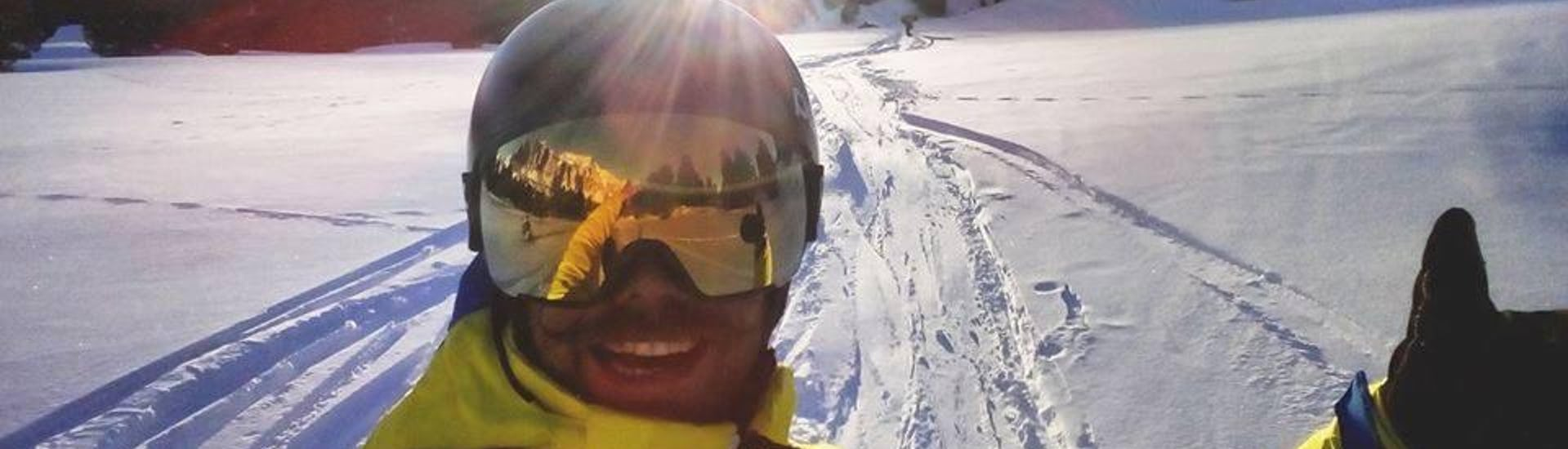 A boy snowboarding on the slopes of Val Gardena
