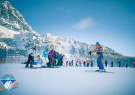 A ski instructors welcomes some skiers to adult ski lessons for all levels with ski school Total Ehrwald at Zugspitze.
