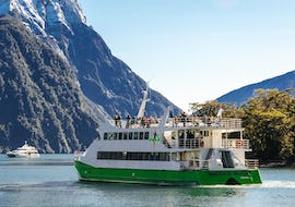 "A catamaran from the company Jucy Cruise is cruising to the 8th wonder of the world during the Milford Sound Cruise ""Classic"" - Summer."