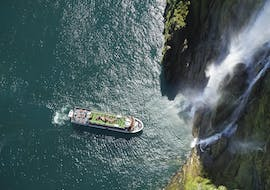Watching majestic landscapes of the fjord during Milford Sound Cruise organized by Go Orange.