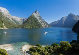 A Southern Discoveries ship is passing by Mitre Peak during the Milford Sound Nature Day Trip from Te Anau.
