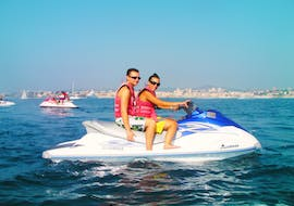 Couple doing a Mini Jet Ski Safari in the Baie des Anges in Nice with Jet Evasion.