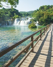 The breathtaking waterfall in the national park in Croatia where you can do mountain biking in Krka.