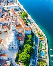 An arial photo of a beautiful city in Croatia where you can do mountain biking in Šibenik.