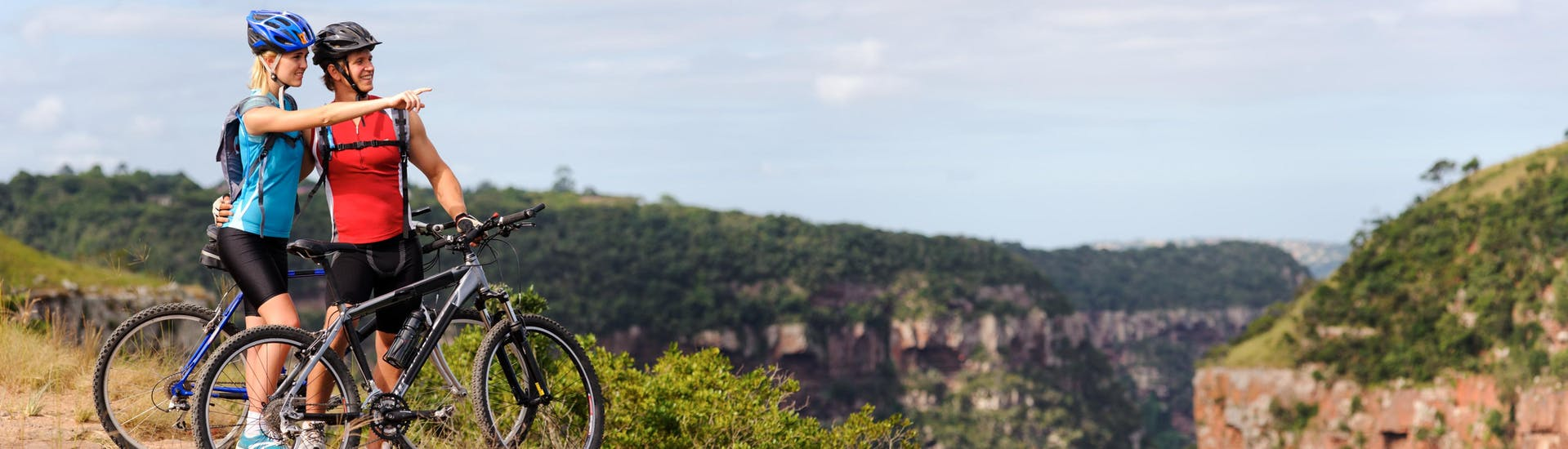 A couple on a mountain bike tour through the Dalmatian countryside is taking a break to enjoy the view.