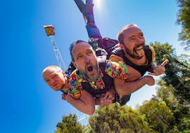 Three friends are hurling to the grounds during the Multi-Ride Package with 2 or 4 Rides in Rotorua in Velocity Valley Rotorua Adventure Park.