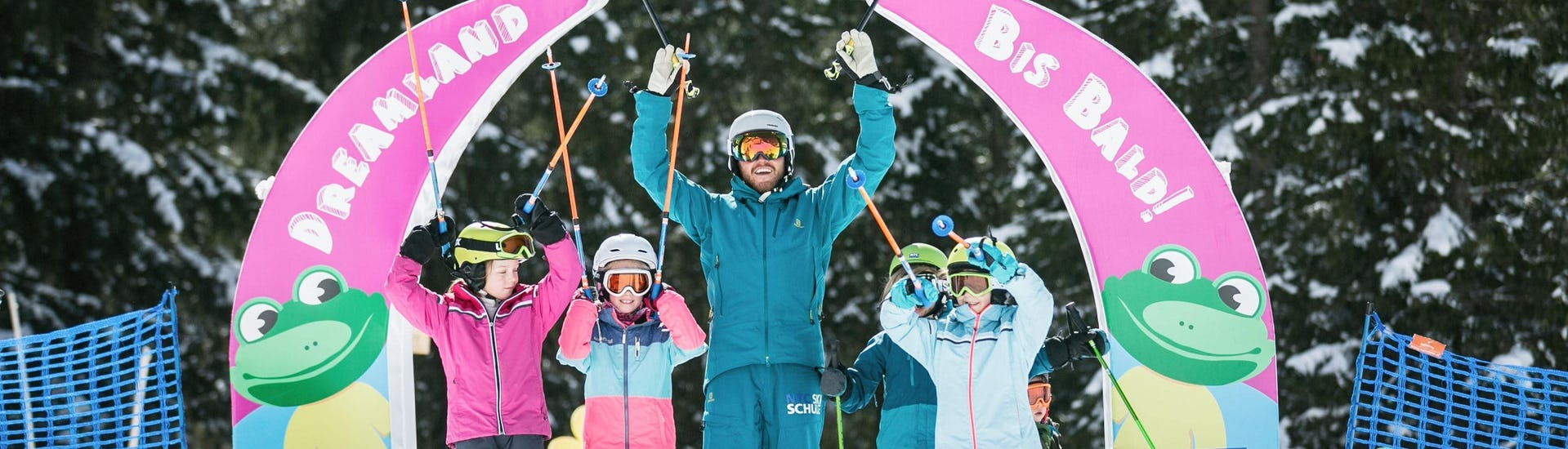 A group of happy children during ski lessons organised by the NTC Skischule Oberstdorf in the ski resort Oberstdorf.