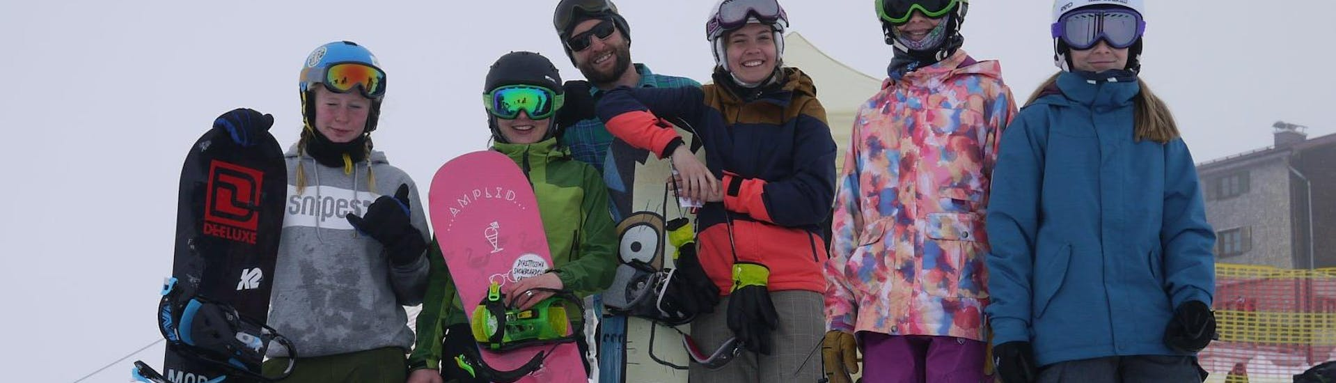 Snowboarders are taking picture as a memory of the Off-Piste Snowboarding Lessons - All Levels organised by the school Out of Bounds Snowboard School.
