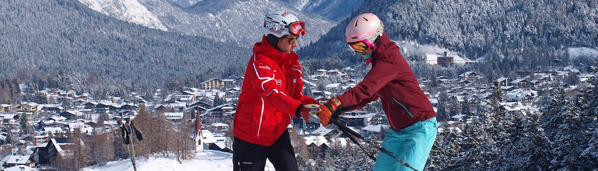 Ski Instructor shows his ski student the right arm position