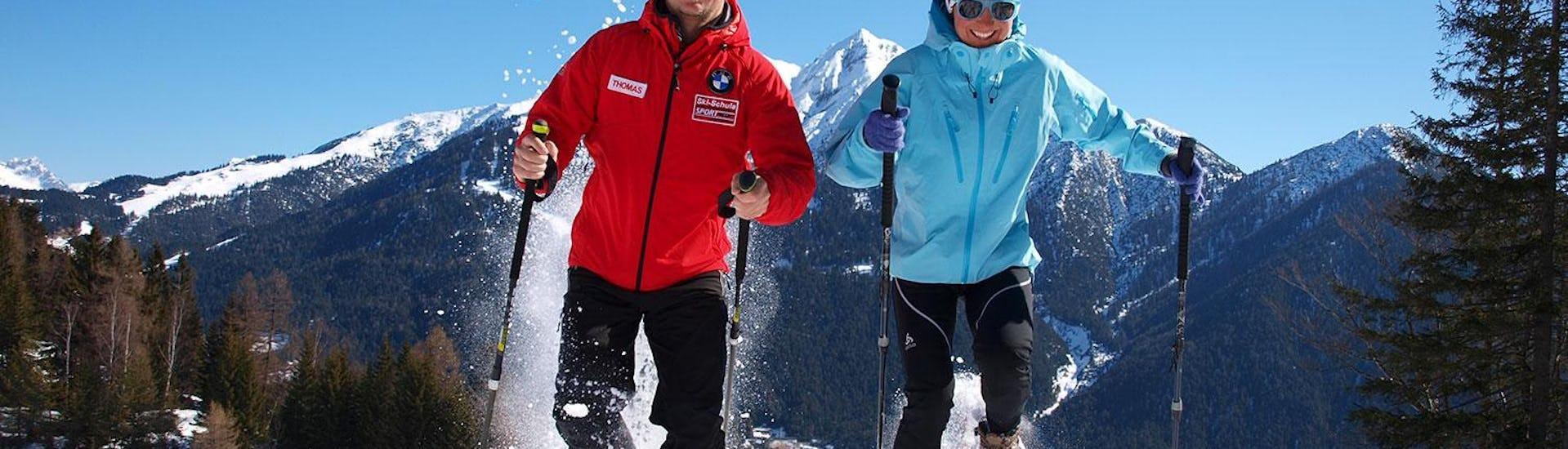 Man and woman at snowshoing at winterland