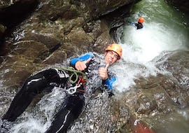 """A man participating to Canyoning """"Discovery"""" - Canyon de Montmin tour with Térreo Canyoning enjoys the water."""