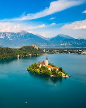 An aerial view of the famous lake with its small church on an island, a sight awarded to those who go paragliding in Bled.