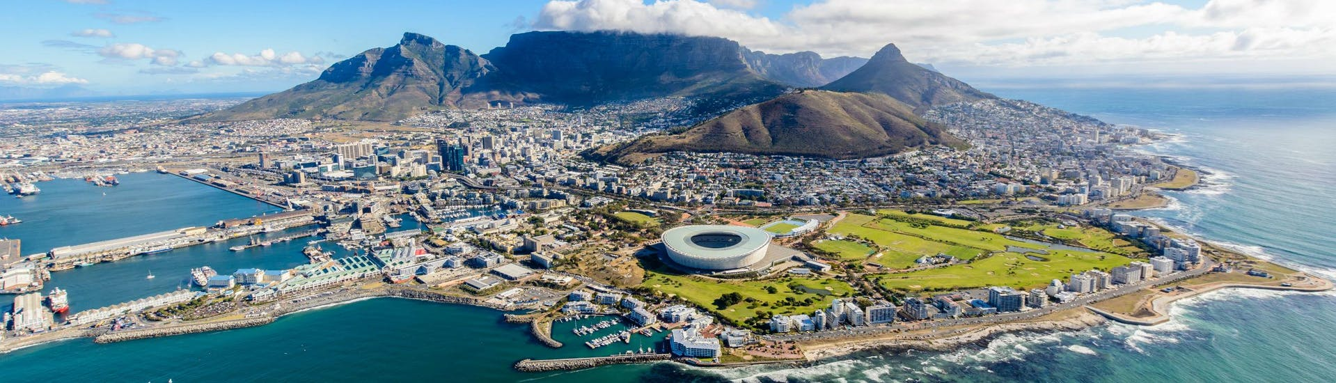 An aereal view of Cape Town, where visitors can go paragliding and fly across the famous Table Mountain.