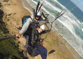 During the Paragliding in Wilderness - Adventure Flight, a qualified pilot from Dolphin Paragliding is flying with girl above stunning landscapes.