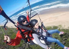 A girl is admiring the scenery during the Paragliding in Wilderness - Standard Flight organised by Dolphin Paragliding Wilderness.