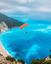 An arial photo of a breathtaking landscape above the greek ocean where you can do paraglidin gin Kafalonia.