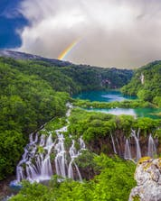 A breathtaking view of the waterfalls in Croatia where you can do paragliding near the Plitvice Lakes.