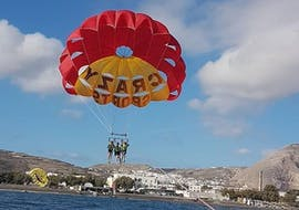 During the Parasailing close to Agios Georgios, a group of friends is enjoying the 360 degree views from a bird's-eye view whilst being towed and watched by professional staff from Crazy Sports.