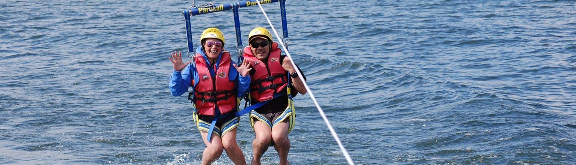 A couple is seemingly excited as they prepare to take off for some Parasailing in Rotorua with Katoa Lake Rotorua.