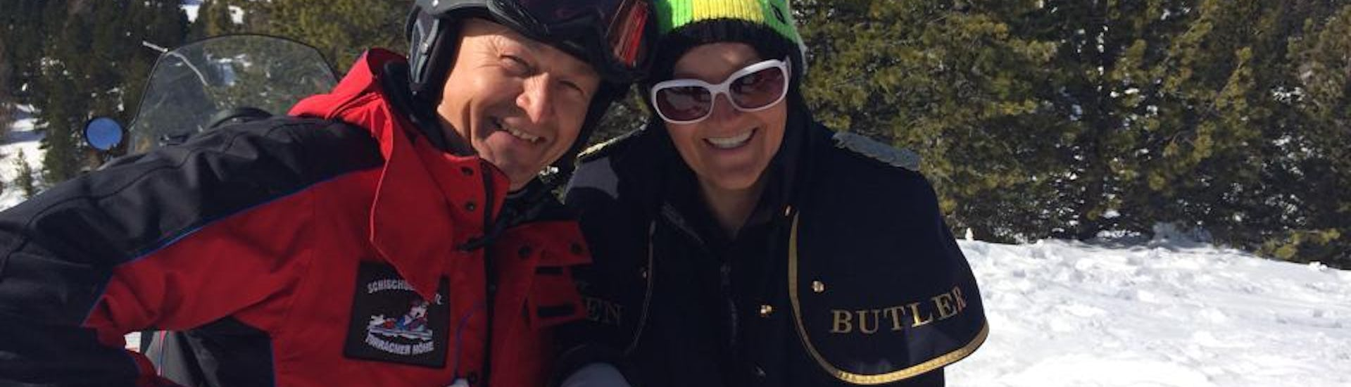 Skiinstructor and student smiling to the camera