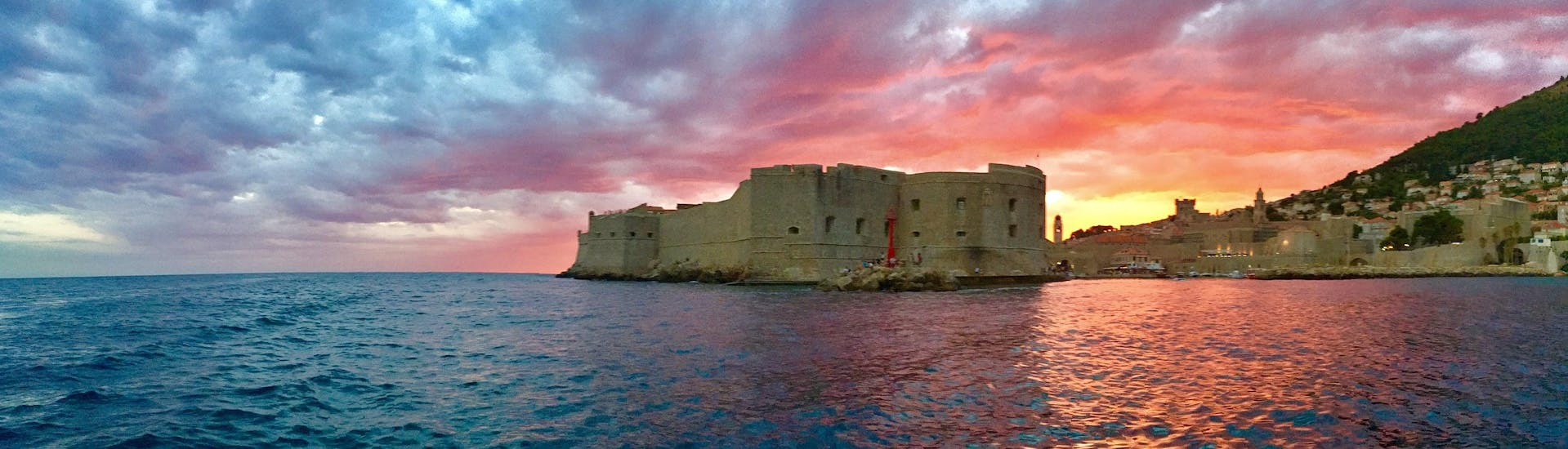 Tourists have a breathtaking view on a fortification during the Private Boat (4pax) to Elaphiti Islands - Explore & Snorkel organised by Explore Dubrovnik by Boat.
