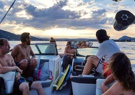 Friends are enjoying their evening thanks to their Private Boat Rental with Wakesurf & Wakeboard on Lake Annecy with Le Spot.