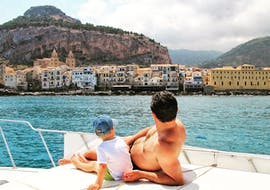 During a Private Boat Trip in Cefalù with Sightseeing with Sea Land Tours Cefalù a little boy and his dad look at the view.