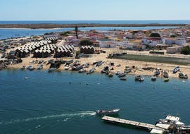 Beautiful and colorful view of a city that you see during the Private Boat Trip in Ria Formosa Natural Park for Families with Odyssey Tours.