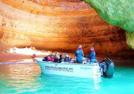 Together with Royal Nautic Portimão, the tour participants enter the interior of an impressive marine cave during their Private Boat Trip to Benagil Cave from Portimão.