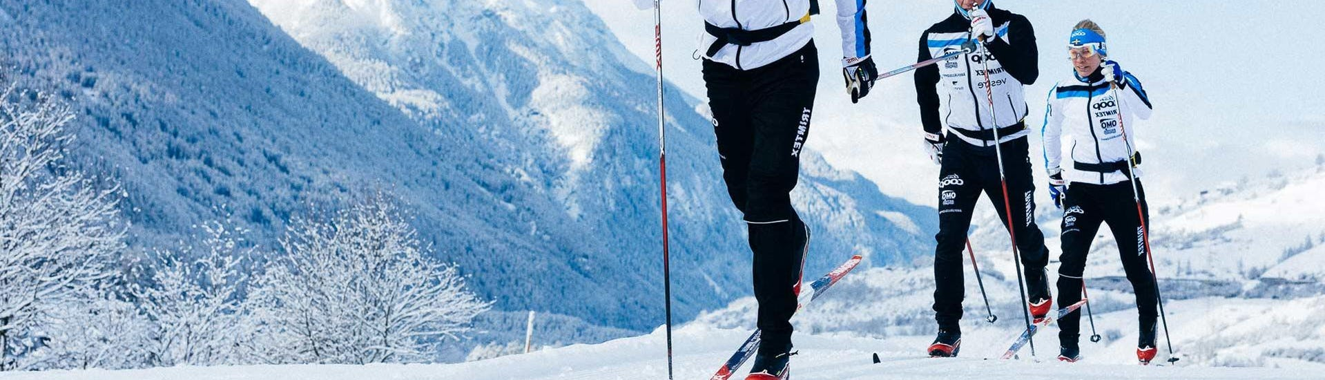 """A group of skiers is enjoying the magnificent landscapes during the Private Cross Country Skiing Lessons """"Classic"""" - All Levels offered by the ski school NTC Skischule Oberstdorf."""