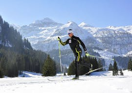 A man rides through the fresh tracks together with the guides from Langlaufschule Gnadenalm during his Private Cross Country Skiing Lessons for All Levels & Ages.