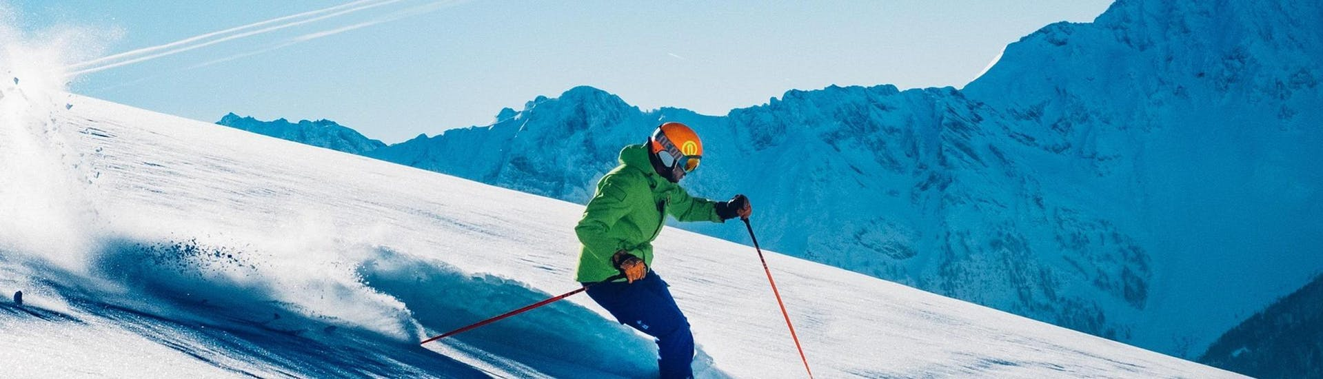 Under the supervision of an experienced instructor from the ski school Scuola di Sci B.foxes, a skier is about to try out some new freestyle tricks during the Private Freestyle Skiing Lessons - For Adults - Christmas.