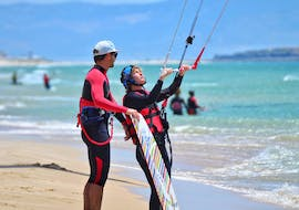 A customer of Addict kite school is practising Private Kitesurfing Lessons for All levels with his instructor of addict kite school in Tarifa.