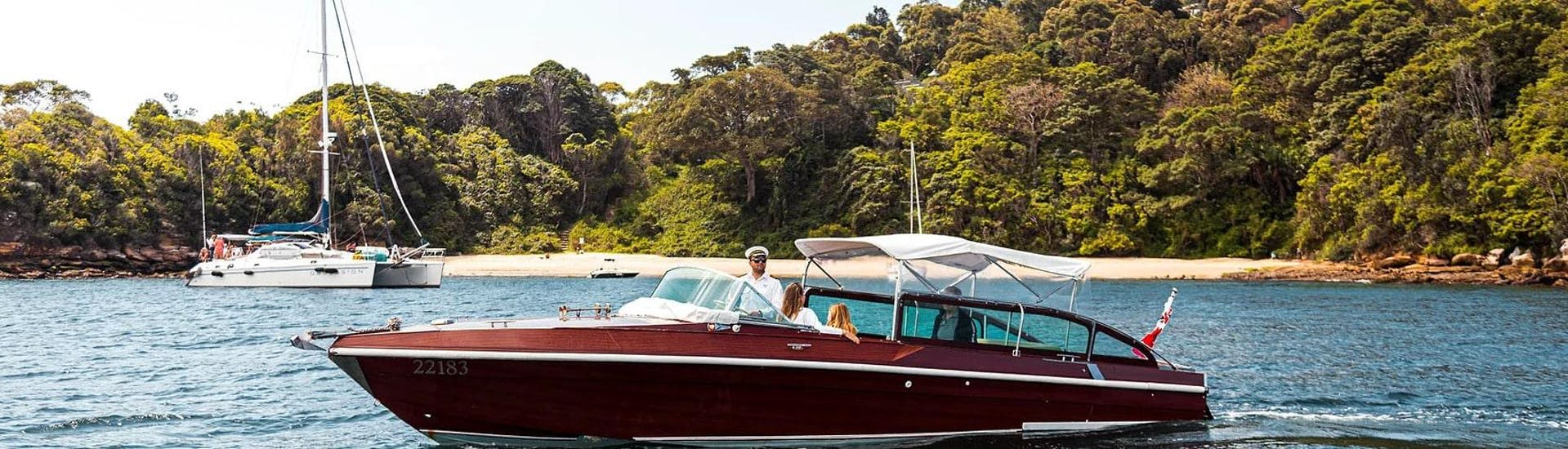 During the Private Luxury Boat Cruise in Sydney to Hidden National Park, tourists are relaxing aboard of hybrid electric vessel from Sydney Luxury Cruise.