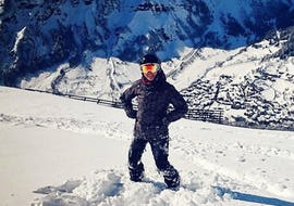 A freerider is standing in the fresh powder snow during his Private Off-Piste Skiing Lessons - All Levels with the ski school Red Carpet Champéry.