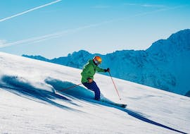 A skier rides down the slopes with an instructor from Scuola di Sci B.foxes during the Private Off-Piste Skiing Lessons - for Adults.