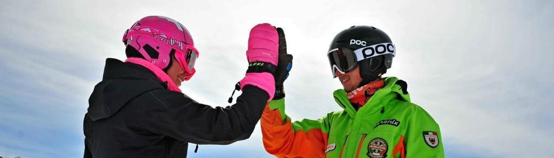 The Private Off-Piste Skiing Tours - All Levels are just finished, the student and the ski instructor of the Ski School Scuola di Sci Aevolution Folgarida are high-fiving.