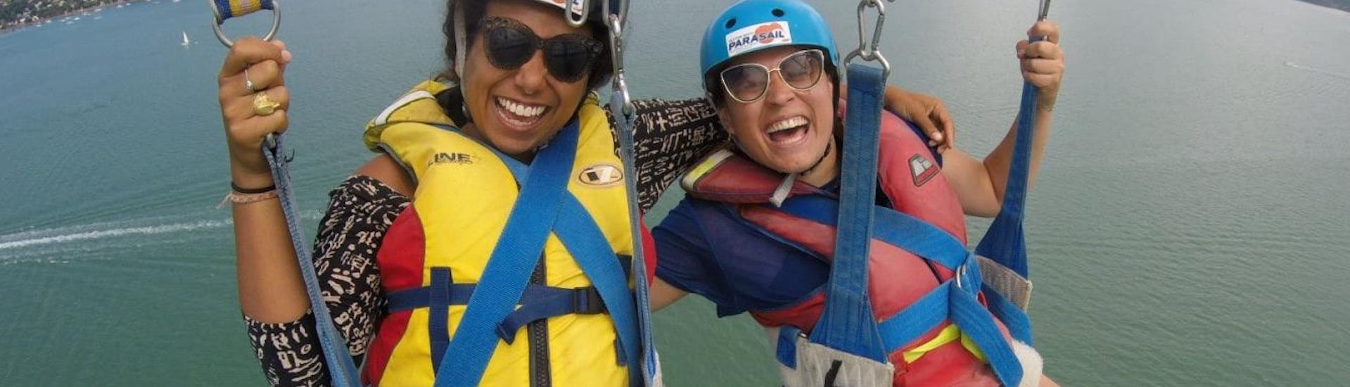 During the Private Parasailing in Paihia - For up to 12 People, two friends are having great time thanks to the experienced team of Bay of Islands Parasail.